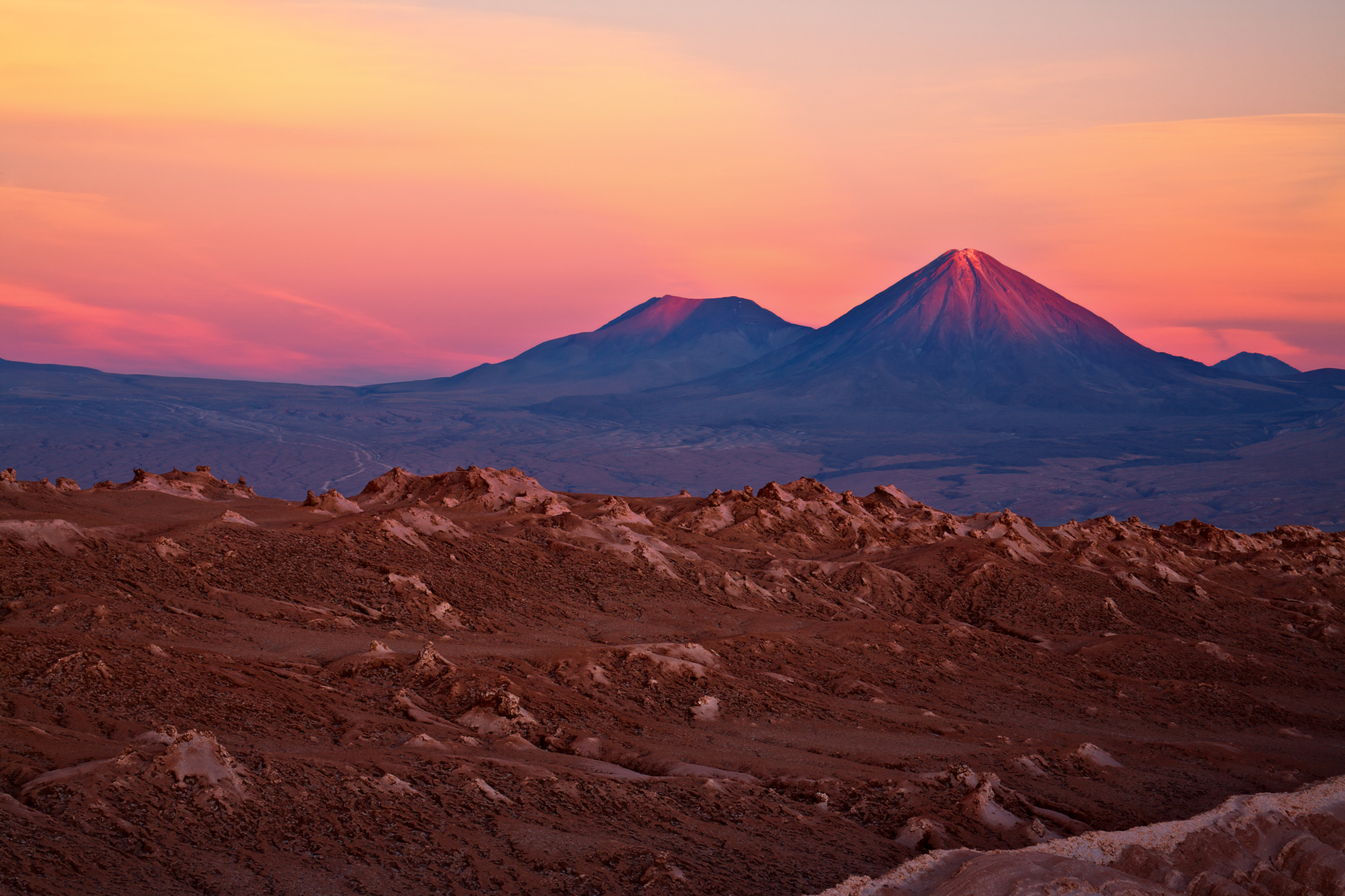 Imagine Traveling To A Place Where Pastel Colored Skies Camouflage With The Rocky Ridges Of One Driest Deserts On Earth Atacama Desert Plateau In