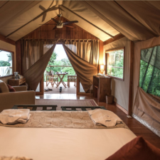 view of the inside of a safari camp tent